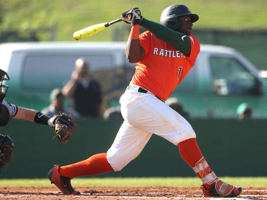 FAMU's Brian Davis makes contact with a pitch against Brown during their game at Moore–Kittles Field on Friday, March 2, 2018.