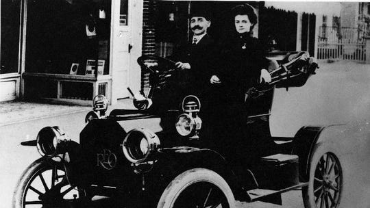 O.C. Bernard and his wife in their first new car, a