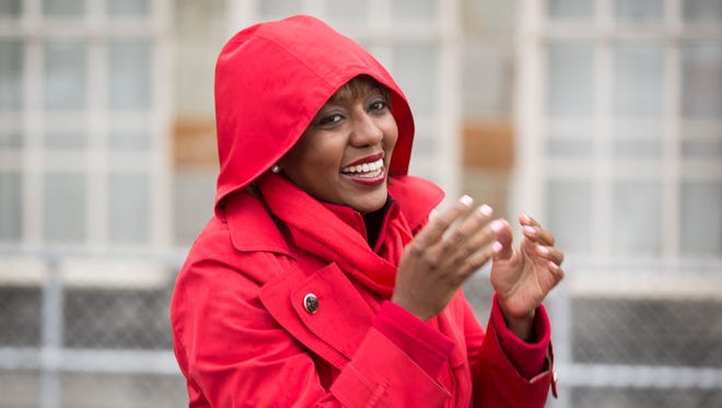 Yvette Simpson, President Pro Tem of Cincinnati City Council, campaigns at Zion Temple First Pentecostal in North Avondale on election day. Voters in the city of Cincinnati are choosing between Mayor John Cranley and Simpson for mayor. Simpson won the primary. She said she thought the race would be close, but feels confidant she'll win.