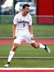 Monroe's Matt Hoyt celebrates after scoring vs. South