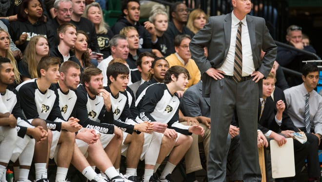 CU coach Tad Boyle and the bench watch the Buffaloes take on the Rams at Moby Arena Sunday, December 6, 2015.