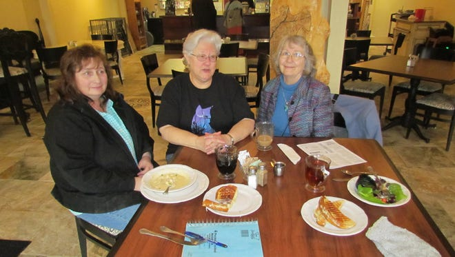 Ongoing preservers of history: Terri Adams, left, Wendy Stone and Diana Maul at Moxieberry in downtown Stayton during a January Canyon Conversations.