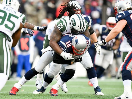 New England Patriots quarterback Tom Brady (12) is sacked by New York Jets nose tackle Steve McLendon (99) during the second half at Gillette Stadium on Dec 31, 2017 at Foxborough, Mass.