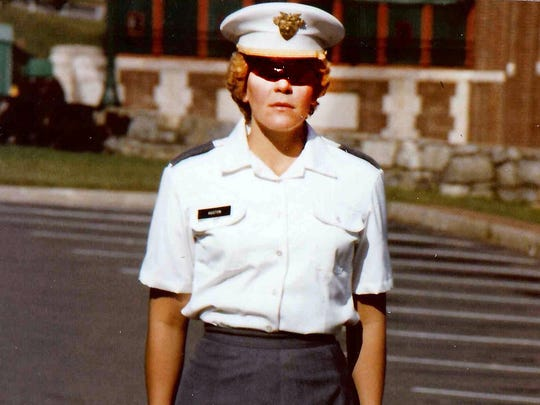 West Point Military Academy cadet Mary Johnson stands at attention for a photo in 1982.