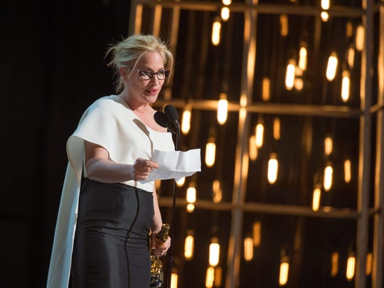 Patricia Arquette accepts the Oscar for best supporting