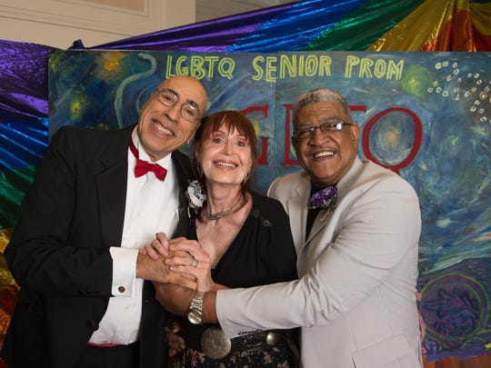 Residents of the John C. Anderson apartments, Michael Palumbaro, Elizabeth Coffey-Williams and Robert Curry share a moment at LGBTQ Senior Prom in Philadelphia.