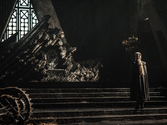 Daenerys Targaryen (Emilia Clarke) examines the ransacked throne room at her family's castle, Dragonstone, in HBO's 'Game of Thrones.'