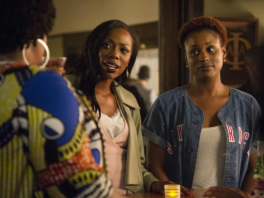 Inseparable friends Molly (Yvonne Orji, left) and Issa