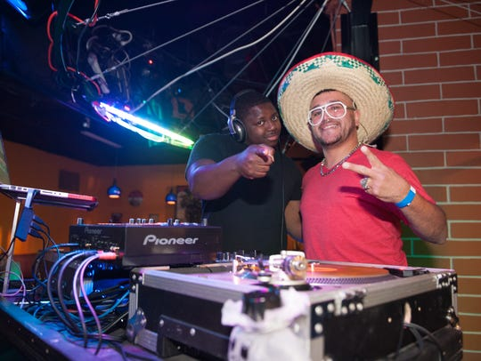 DJ Def and DJ Hazardous rock out inside of Tempe's Fat Tuesday during a Cinco de Mayo celebration in 2013. The longtime Tempe venue is expanding to Westgate in spring 2018.