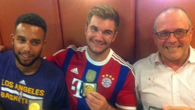 Anthony Sadler, from Pittsburg, Calif.; Alek Skarlatos from Roseburg, Ore.; and British national Chris Norman, who is living in France, hold their medals as they sit in a restaurant after a brief ceremony in the town of Arras, northern France, on Aug. 21, 2015. The American servicemen overpowered a gunman armed with a Kalashnikov who opened fire on a high-speed train travelling from Amsterdam to Paris on Aug. 20, 2015.