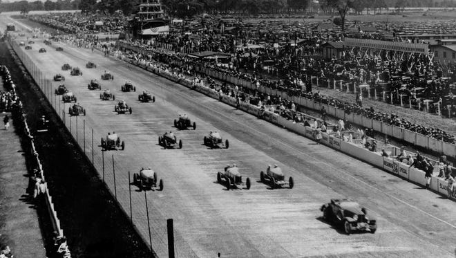 The pace car leading the field on the pace lap of the 1930 Indianapolis 500 is a Cord L-29 Roadster.