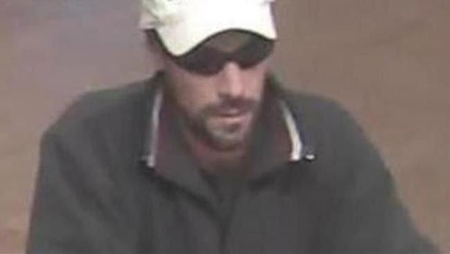 Surveillance photo of the at-large bank robber.
