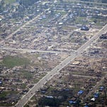 A view of tornado damage as Air Force One carries US President Barack Obama to Joplin, Missouri May 29, 2011. Victims of the tornado continue to recover as 2011 becomes the deadliest year for tornadoes since 1953. The death toll stood at 142 one week after the tornado cut a path of death and destruction through the heart of this town of 50,000.  AFP PHOTO/Brendan SMIALOWSKI (Photo credit should read BRENDAN SMIALOWSKI/AFP/Getty Images)