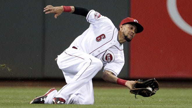 Billy Hamilton makes a sliding catch in center field during an Aug. 5 game against the Cardinals.