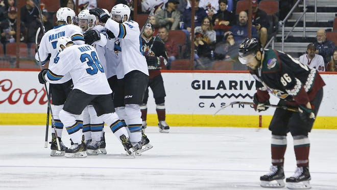 Josh Jooris (86) reacts as the San Jose Sharks celebrate a goal by center Micheal Haley (38) during the second period of their NHL game Saturday, Feb. 18, 2017 in Glendale, Ariz.