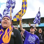 Louisville City FC fans cheer after Saturday's match. Louisville lost 2-0 to New York Red Bull II in the team's home opener.