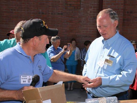 Vietnam veteran William Bayne Anderson, right, receives