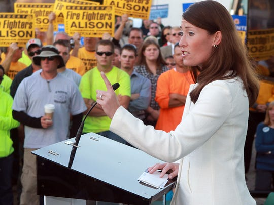 Alison Lundergan Grimes addressed supporters Wednesday at a rally at the World Peace Bell in Newport.