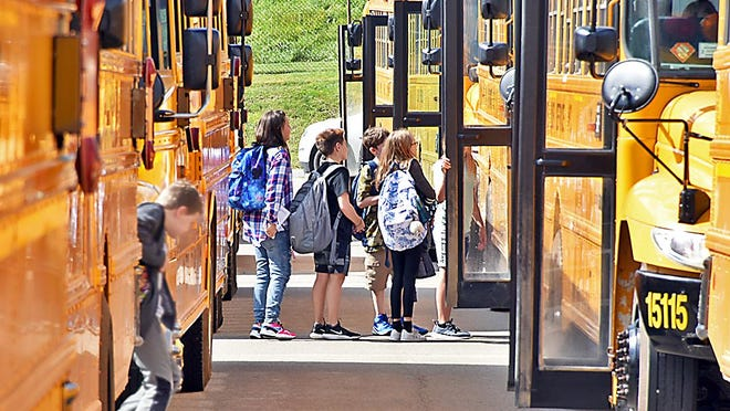 Students board buses outside of Corning-Painted Post Middle School in a September 2019 file photo.