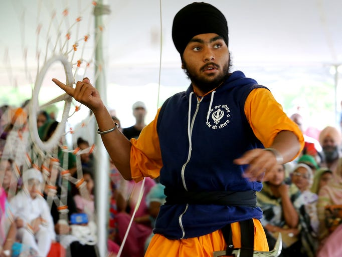 Jasprret Singh, of Stockton, Calif., performs with the chakar during Yudh 2014, a gatka tournament, at Gurdwara Sahib (Sikh Temple), on Saturday, August 30, 2014, in Greenwood. This is the 12th annual tournament and the first time it has been held in Indiana.