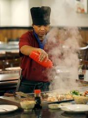 Chef Cin Khan prepares a meal on the hibachi grill at Ichiban.