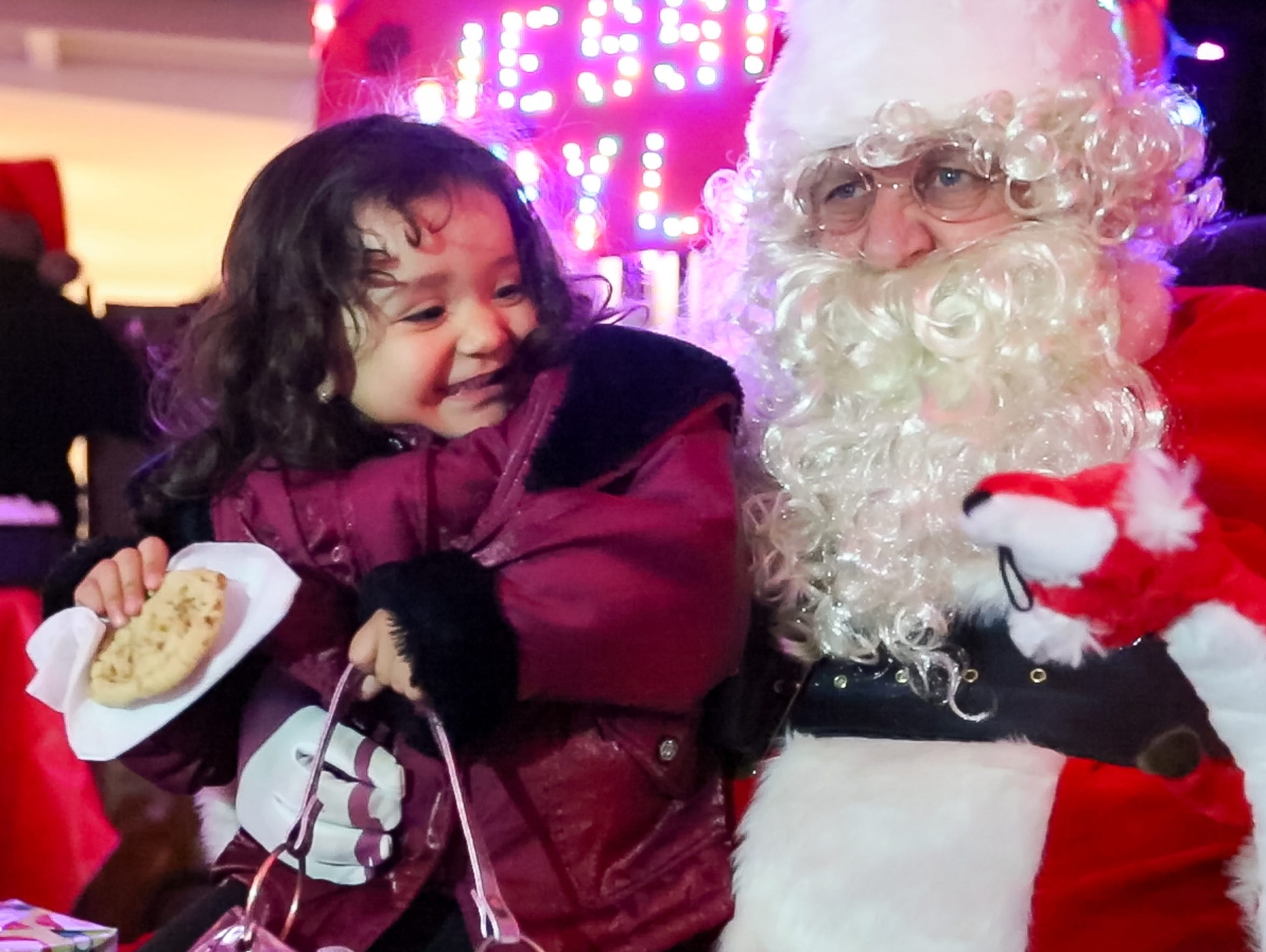 Juliette Oliver, 2, of Las Cruces, visits with Santa