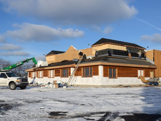 Workers continue progress on the Texas Roadhouse Monday, Jan 26, next to Birchwood Mall in Fort Gratiot.