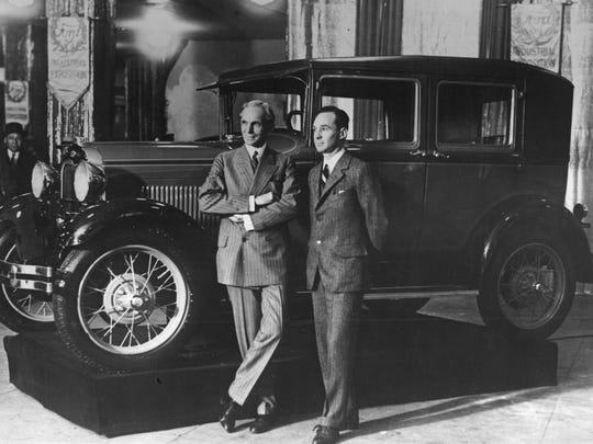 Henry Ford and Edsel Ford at New York's Madison Square Garden with Model A car.