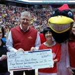 Community State Bank Senior Vice President Kathy Nichols and President and CEO Ron Nagel present a check for $11,710, from the sale of Fred Hoiberg commemorative prints, to the American Heart Association's Heart Ball Director Kim Hanken and Heart Walk Director Kim Olmstead.