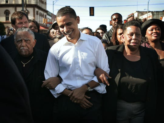 Then-senator Barack Obama marches with a crowd to the
