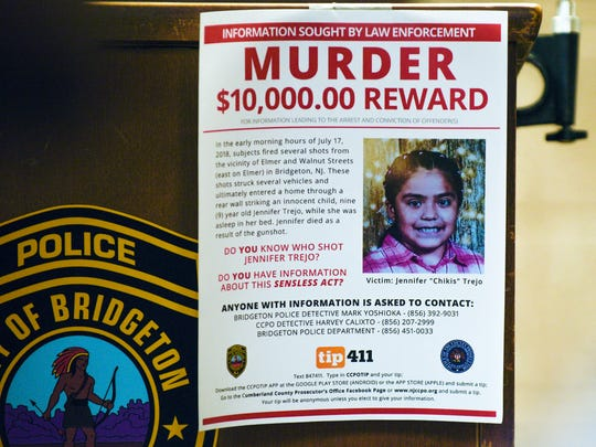 A flyer offering a reward for information on the death of 9-year-old Jennifer Trejo hangs from a podium during a press conference Tuesday, July 17, 2018 in Bridgeton, N.J.