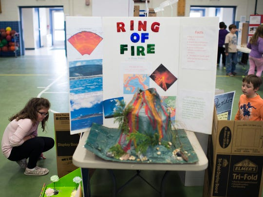 Students browse fellow classmates' projects as Lord Baltimore's science fair is held Wednesday, March 25, in Ocean View.