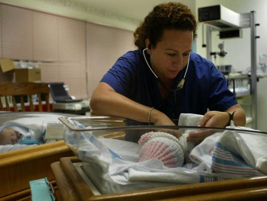 Sandra Deegan works with newborns in this 2002 file photo from Jersey Shore University Medical Center in Neptune. On average,