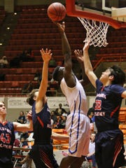 North Side's Caleb Hall goes up for a shot in the championship game of the HUB Classic.