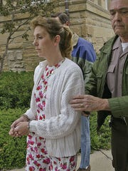 Dixie Shanahan Duty is led from the Shelby County Courthouse after a jury found her guilty of second-degree murder April 30, 2004, in the killing of her former husband, Scott.