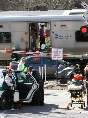 A northbound MetroNorth commuter train struck a disabled vehicle at the Green Lane crossing in Bedford Hills April 27, 2016. The two people in the car were able to escape the vehicle before it was struck. There were no injuries on the train.
