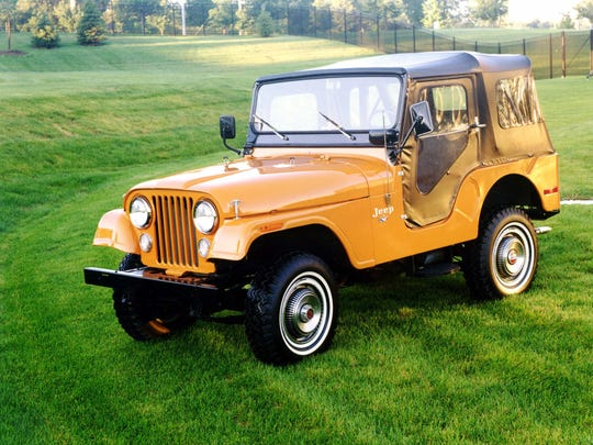 """Arguably one of the ugliest Jeep variants due to its """"Transport Yellow"""" paint, the 1973 CJ-5 features a soft top and white wall tires."""