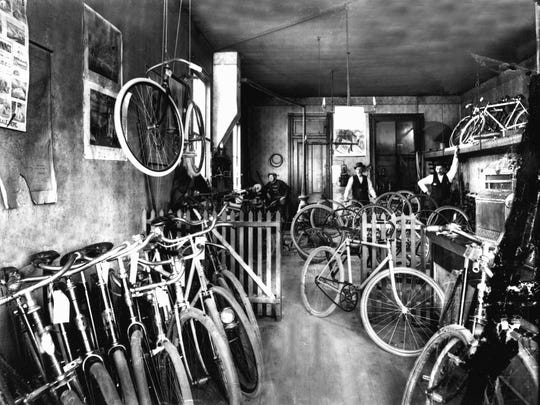 Not all forms of transportation were motorized, of course. A bicycle shop in downtown displays repaired and new bicycles during the bicycling craze of the late 1890s.