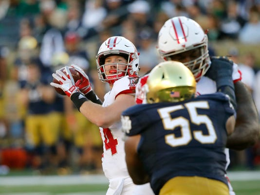 Miami (Ohio) quarterback Gus Ragland drops back and throws a touchdown pass to wide receiver James Gardner as Notre Dame defensive lineman Jonathan Bonner (55) defends during the first half of an NCAA college football game Saturday, Sept. 30, 2017, in South Bend, Ind. (AP Photo/Charles Rex Arbogast)