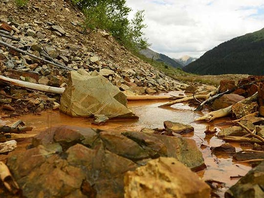 Local elected leaders were engrossed in closed talks Wednesday with federal and state officials over a possible environmental disaster designation that could lead to a Superfund cleanup of inactive mines contaminating headwaters of the Animas River in southwestern Colorado.