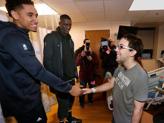 Milwaukee Bucks player Malcom Brogdon greets Josh Golden, a patient, as the Milwaukee Bucks visited Children's Hospital of Wisconsin.