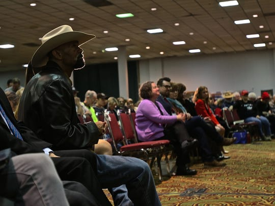 Former Milwaukee County, Wis., Sheriff David A. Clarke Jr. listens to speakers during the 2018 Freedom Rally on Saturday, Feb. 3, 2018.