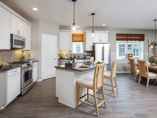 The Kokes Family Home Builders' Saratoga house model is an open-concept design that's very popular among 55+ buyers. This kitchen is located at the Reserve of Lake Ridge.