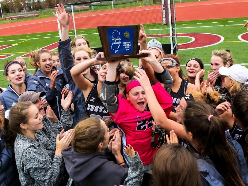 Members of the Bishop Eustace Prep field hockey team celebrate winning the Non-Public South title at Bridgeton on Wednesday.
