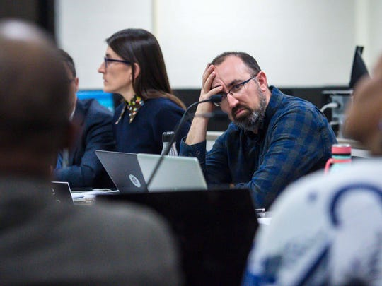 Mike Fisher of the Burlington School Board listens as Superintendent Yaw Obeng, left, explains proposed reductions in force on Tuesday, April 10, 2018.