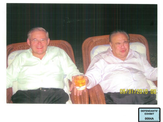 U.S. Sen. Bob Menendez, left, lounges next to Salomon Melgen at Melgen's home in the Dominican Republic in a photo dated May 31, 2010.