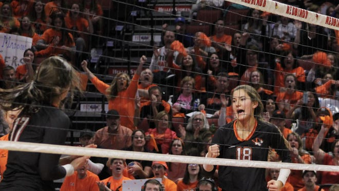 Wheaton Warrenville South players and fans react to a score during the Illinois High School Association state semifinals held Nov. 15, 2019, at Redbird Arena. Under the modified schedule, volleyball's state finals have moved to the spring 2021.
