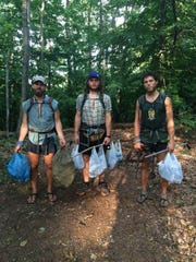 "from left Seth ""Cap"" Orme, Joe ""Goose"" Dehnert, Paul ""Spice"" Twedt packing out 60 pounds of glass from the Appalachian Trail."