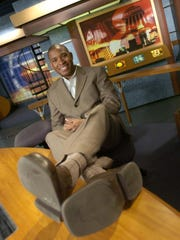 Sports anchor Anthony Calhoun poses at WISH-8 in 2004.
