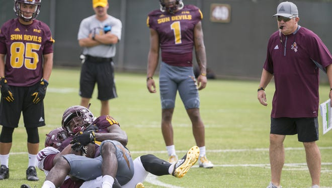 ASU's head coach Todd Graham watches over tackling drills at ASU's practice fields in Tempe, Ariz. on July 30, 2017.